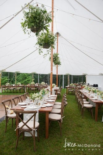 sailcloth tent with farm tables