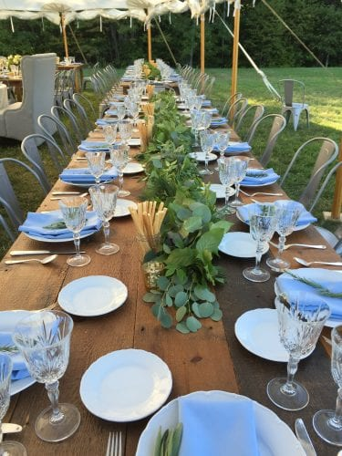 farm tables with garlands