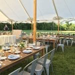 summer wedding farm tables and metal bistro chairs